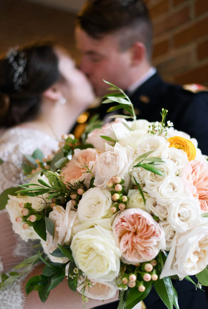 Bride-and-military-groom-with-bouquet