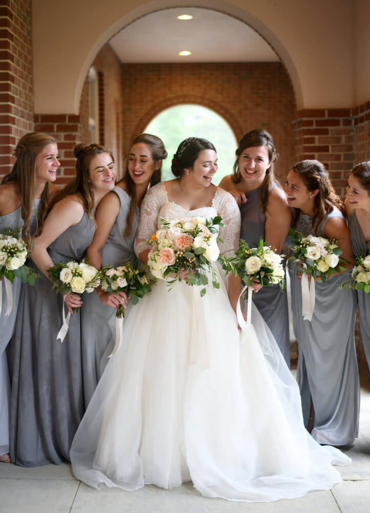 St-Bedes-Catholic-Church-bridesmaids-and-bride-with-bouquets